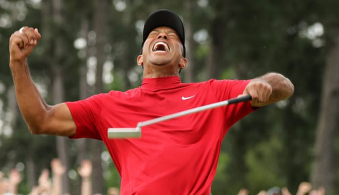 Tiger Woods celebrates after sinking his putt on the 18th that won a fifth Masters at Augusta National. Photograph: Lucy Nicholson/Reuters
