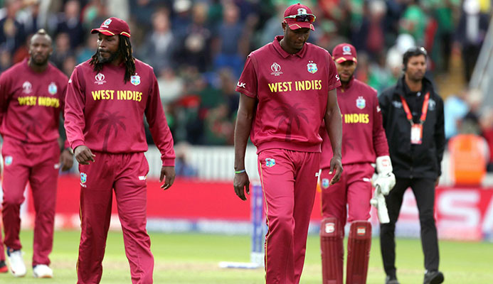 DEJECTED! West Indies captain Jason Holder, centre, lead his players walk off dejected after losing the Cricket World Cup match between West Indies and Bangladesh at The Taunton County Ground, Taunton, south west England, yesterday. (AP)